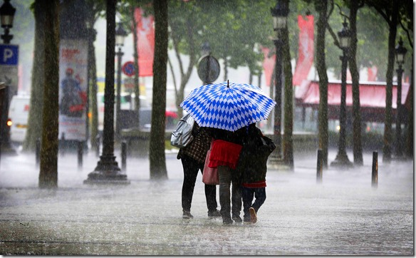 People walk under the heavy rain on the ...People walk under the heavy rain on the Champs-Elys es avenue on June 17, 2013 in Paris. AFP PHOTO / FRANCOIS GUILLOTFRANCOIS GUILLOT/AFP/Getty Images